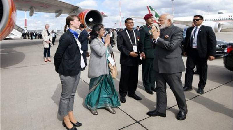 Prime Minister Narendra Modi emplanes for New Delhi after the successful visit to Israel and 12th G-20 Summit in Hamburg, Germany on Saturday. (Photo: PTI)