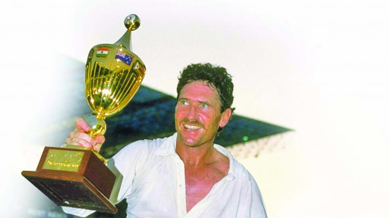 Australia skipper Allan Border celebrates, holding the 1987 World Cup.