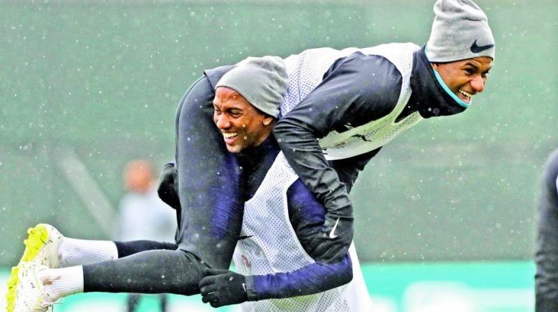 England's Ashley Young (left) shares a light moment with Marcus Rashford during a training session. (Photo: AP)