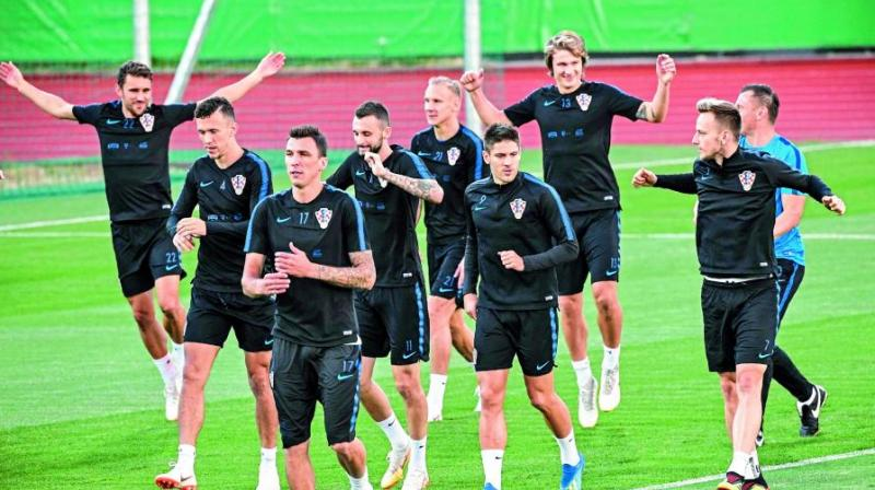 Croatian players flex their muscles as they take part in a practice session at the Luzhniki training field in Moscow ahead of their semifinal match against England. (Photo: AFP)