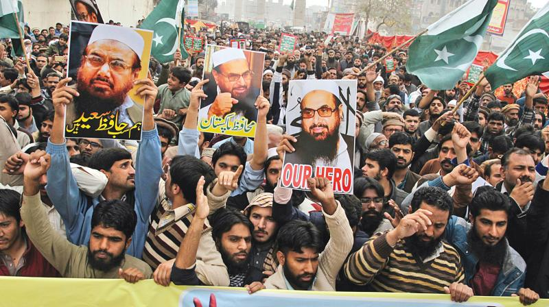 Supporters of Hafiz Saeed, head of the Lashkar-e-Tayyaba and its front organisation Jamaat-ud-Dawa, protest in Lahore recently after the Pakistani authorities took him into custody after rising international pressure. (Photo: AP)