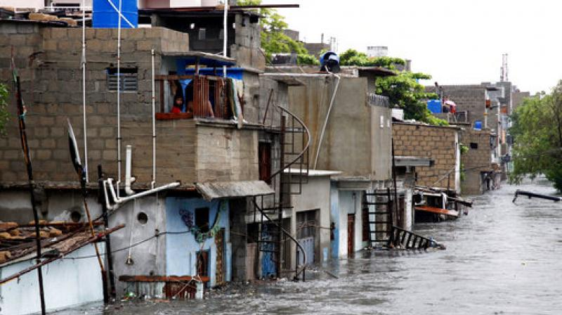 Heavy rains on Tuesday brought Mumbai to a halt flooding vast areas of the city, people were stranded for hours as train services were halted and water levels kept creeping up. (Photo: AP)