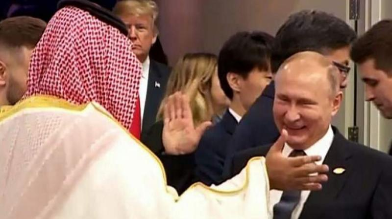 Their embrace comes amid reports that Russia and Saudi Arabia have reached a pact to cut oil production when the OPEC cartel meets on December 6 in Vienna, to help shore up collapsing crude prices. (Photo: AFP)