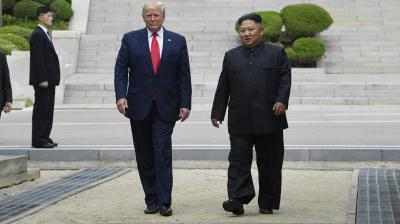 President Donald Trump and North Korean leader Kim Jong Un walk on the North Korean side in the Demilitarized Zone, Sunday, June 30, 2019 at Panmunjom. (Photo: AP)