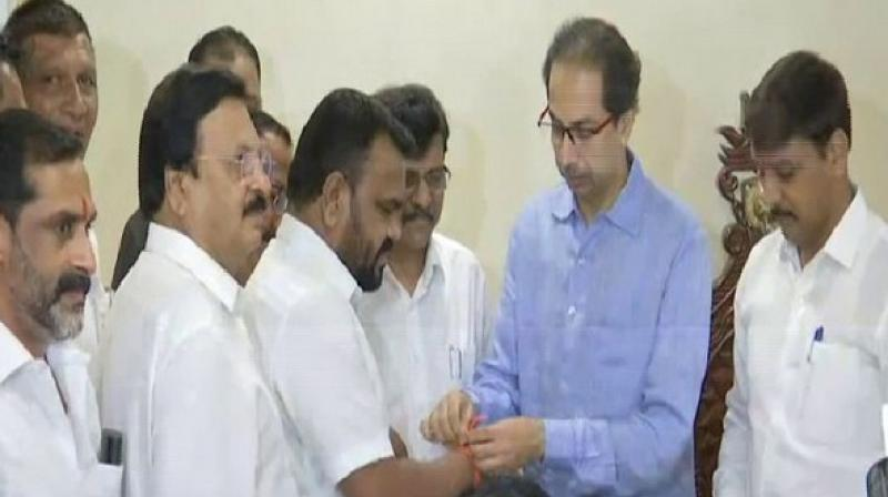 'Nationalist Congress Party (NCP) MLAs Dhanraj Mahale and Dilip joined the Shiv Sena in the presence of party chief Uddhav Thackeray,' Photo: ANI)