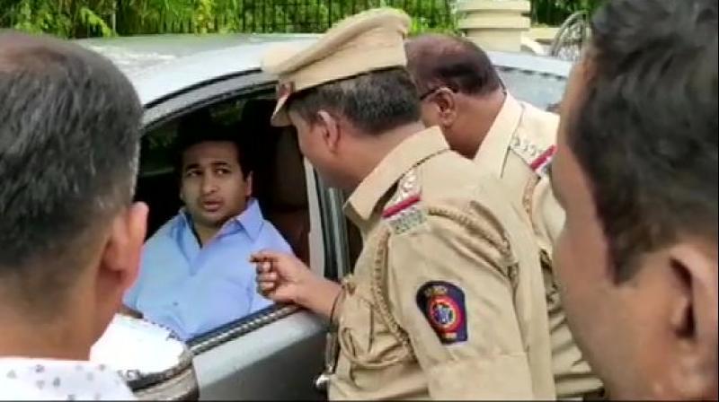 Maharashtra Congress MLA Nitesh Narayan Rane on Thursday evening surrendered before Kankavali police. (Photo: Twitter/ ANI)
