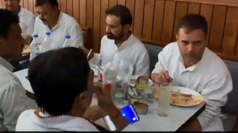 Congress leader Rahul Gandhi on Saturday visited a restaurant in Patna's Maurya Lok Place after a Patna court granted him bail in a defamation case. (Photo: Twitter/ screengrab)