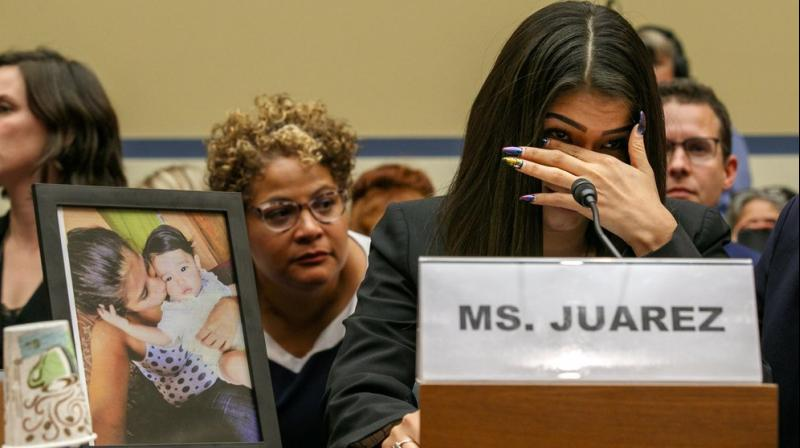 A Guatemalan woman whose infant daughter died after being held by US immigration authorities denounced the 'cruelty' of the country's migrant detention centres on Wednesday. (Photo: AP)