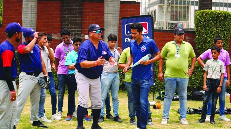 Delhi Capitals assistant coach Mohammad Kaif with kids at the MLB clinic in the capital.