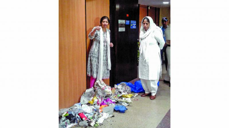 Dry waste dumped by Congress councillor Guddi Devi (right) in front of the office of NDMC Commissioner Varsha Joshi. (Photo: PTI)
