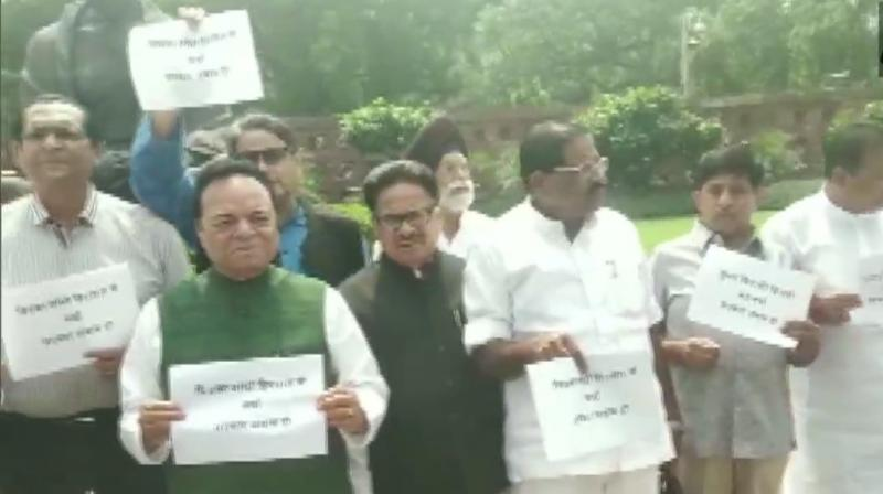 Congress MPs held a protest in Parliament premises on Monday over the Sonbhadra violence. (Photo: Twitter/ ANI)