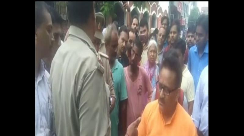 An FIR was registered against Arvind Singh, Katghar Mandal president of BJP, Moradabad, for allegedly misbehaving with the police on Wednesday. (Photo: ANI)
