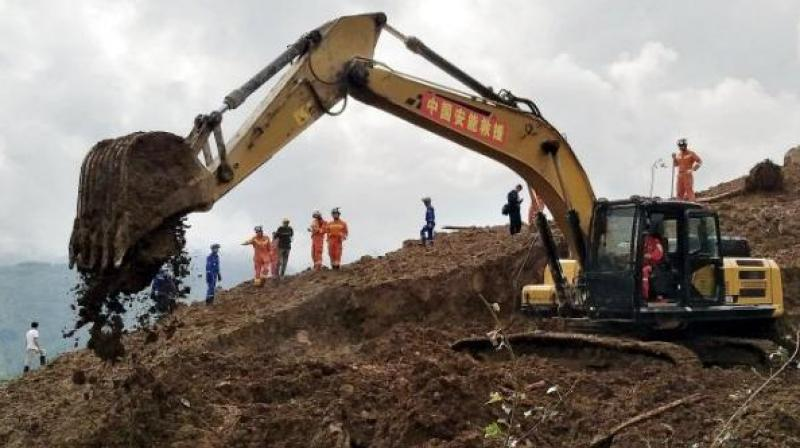 The death toll in a landslide which buried a village in southwest China rose to 29, according to state media, with 22 still missing days after the disaster struck. (Photo: AP)