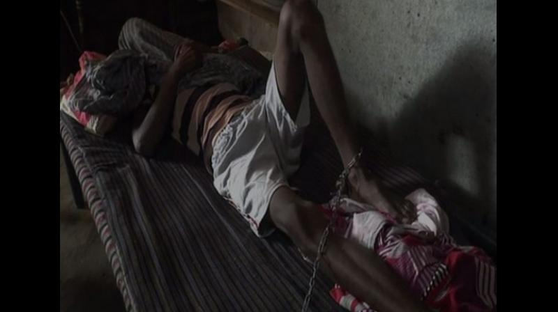 The 35-year-old Jasbeer Singh is married and has two children. When his family got to know about his suicide attempt, they tied him up with chains. (Photo: ANI)