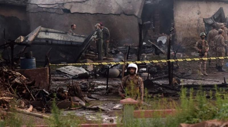 The website of newspaper The News carried footage showing a building engulfed in flames. (Photo: AFP)