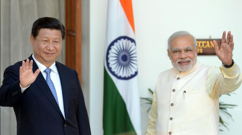 Chinese President Xi Jinping (L) and Indian Prime Minister Narendra Modi . (File Photo- AFP)