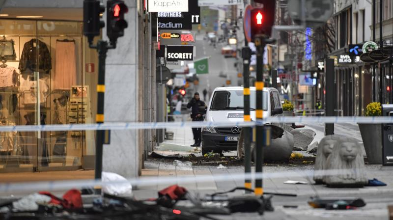 A police officer stands at the cordoned off area following a suspected terror attack on the Drottninggatan Street in central Stockholm, Sweden. (Photo: AP)
