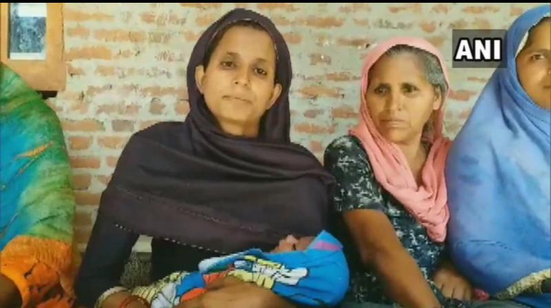 The infant's mother Menaj Begum also hailed the governance of the Narendra Modi government and expressed hope of being benefited by the next government's schemes. (Photo: ANI)