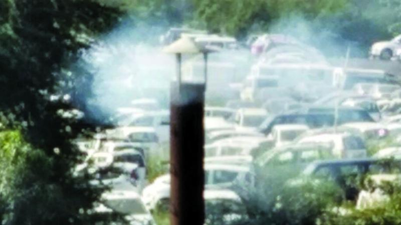 A chimney emits smoke