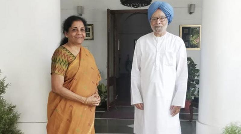 Union Finance Minister Nirmala Sitharaman on Thursday met former Prime Minister Manmohan Singh at his residence. (Photo: Twitter/ ANI)