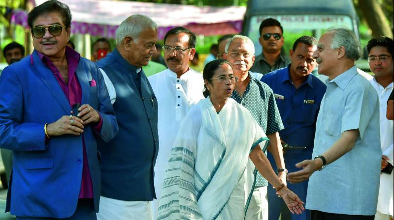 BJP MP Shatrughan Sinha, former Union ministers Yashwant Sinha and Arun Shourie with West Bengal CM Mamata Banerjee before a meeting at the TMC party office in New Delhi. (Photo: PTI)