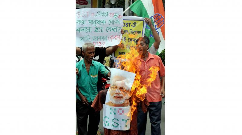 Congress party activists protest against GST rollout in Kolkata on Saturday. (Photo: PTI)