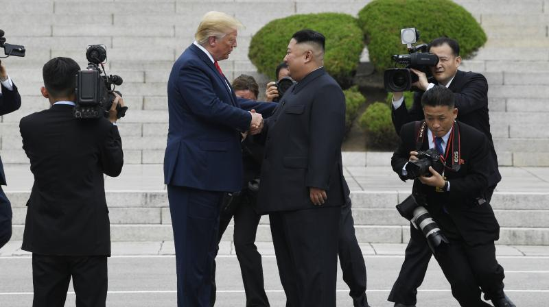 After shaking hands with Kim over the line that marks where their two countries and their allies fought each other to a standstill in the 1950-53 Korean War, Trump walked for several steps into North Korean territory, before another handshake. (Photo: AP)