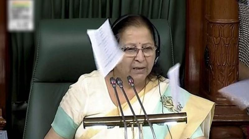 Papers being thrown towards Speaker Sumitra Mahajan in Lok Sabha by Congress MPs on Monday.