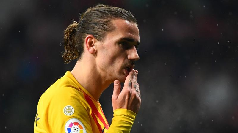 Atlético Madrid is facing punishment after its fans made threatening chants against former player Antoine Griezmann. (Photo: AFP)
