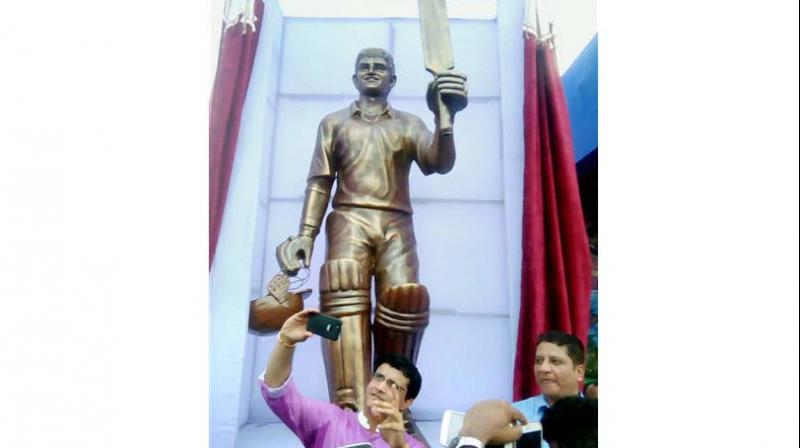 Sourav Ganguly takes a selfie of his own fibre statue at Balurghat Stadium, in West Bengal. (Photo: PTI )