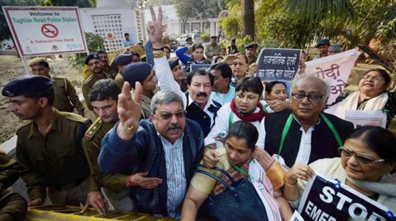 Trinamool Congress MPs shouting slogans after Bandyopadhyay were taken into police custody. (Photo: AP)
