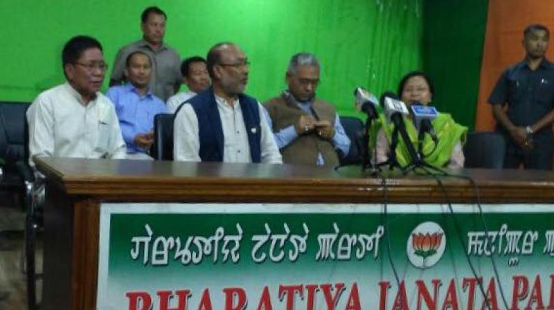 Former Congress MLA Ginsuanhau Zou (left) and Manipur CM Biren Singh (Photo: PTI)