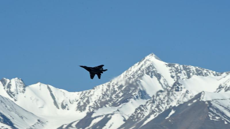 An Indian fighter jet flies over a mountain range near Leh, the joint capital of the union territory of Ladakh. AP Photo