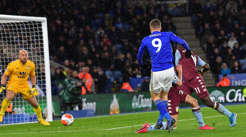 Leicester City's English striker Jamie Vardy (9) shoots to score their third goal during the English Premier League match against Aston Villa at King Power Stadium in Leicester on Monday. AFP Photo
