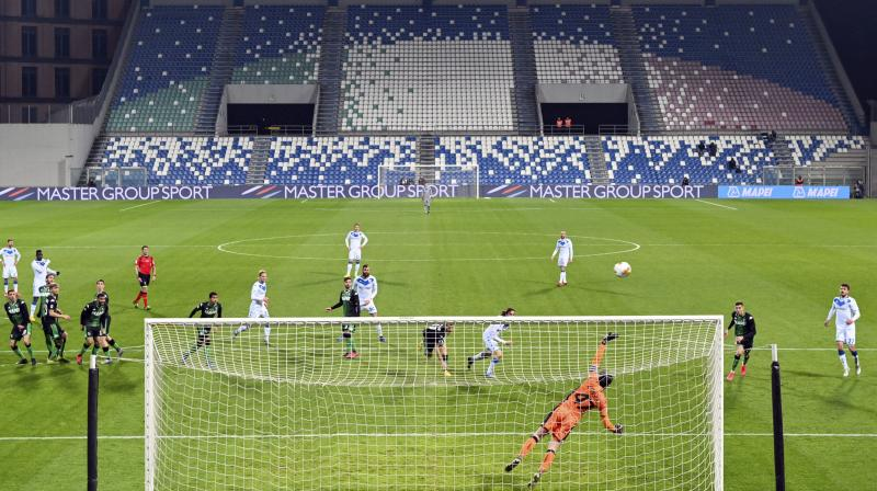 A view of the empty stands at the Mapei stadium as the Serie A soccer match between Sassuolo and Brescia is being played behind closed doors, in Reggio Emilia, on Monday. AP Photo