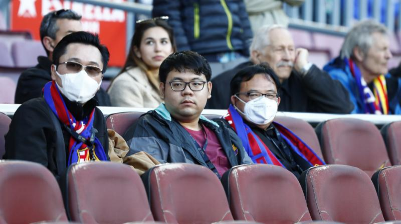Spectators at the Camp Nou Stadium watch the Barcelona v Real Sociedad match in the Copa del Ray last Saturday. AP Photo