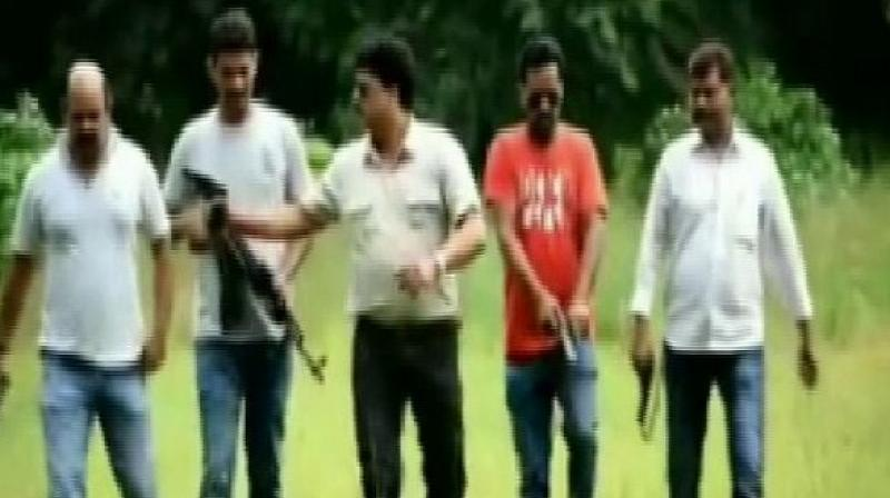 The police inspector is seen flaunting gun in his hand with background music in the video. (Photo: ANI)