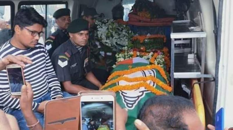 A few photos of the BJD flag on the jawan's coffin went viral on social media on Thursday night and quickly triggered an outrage. (Photo: Twitter   @AmitabhMohanty9)