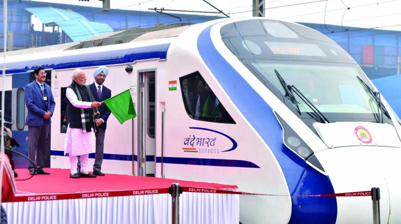 Prime Minister Narendra Modi flags off Vande Bharat Express, India's first semi-high speed train at New Delhi railway station on Friday. The train has been able to attain a maximum speed of 130 kmph during its inaugural run between Delhi and Varanasi, officials said. (Photo: Asian Age)