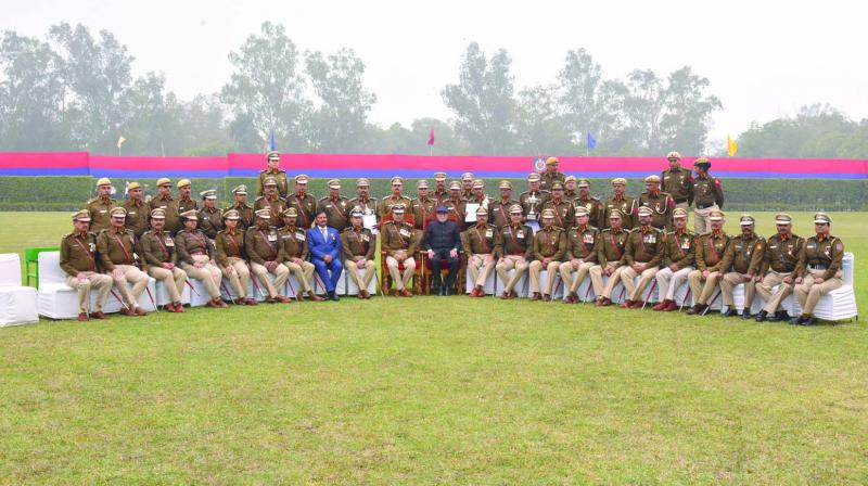 Winners of the various police medals with L-G Anil Baijal at the New Police Lines in Kingsway Camp on Saturday. (Photo: Asian Age)
