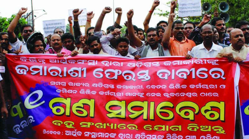 Small depositors who lost money in chit fund scam demonstrating in Bhubaneswar.