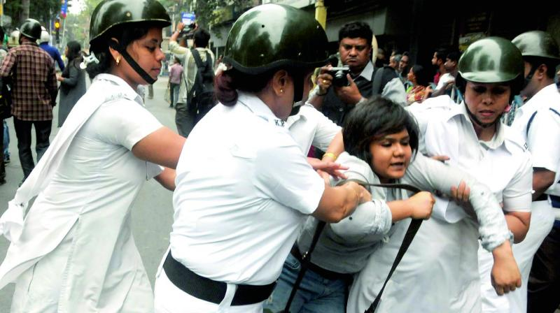 Police personnel detain a Left student during their protest in north Kolkata on Friday against the killing of a labourer in Rajasthan on Wednesday.