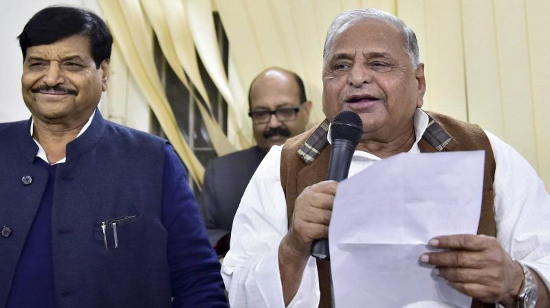 Mulayam Singh Yadav with Shivpal Yadav (Photo: PTI)