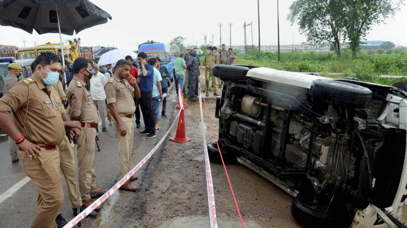 Police inspect the encounter site where gangster Vikas Dubey was killed when he allegedly tried to escape from the spot following an accident, near Kanpur, Friday morning, July 10, 2020. Dubey, accused of killing eight policemen, was being brought to Kanpur from Ujjain in Madhya Pradesh a day after his arrest. (PTI)