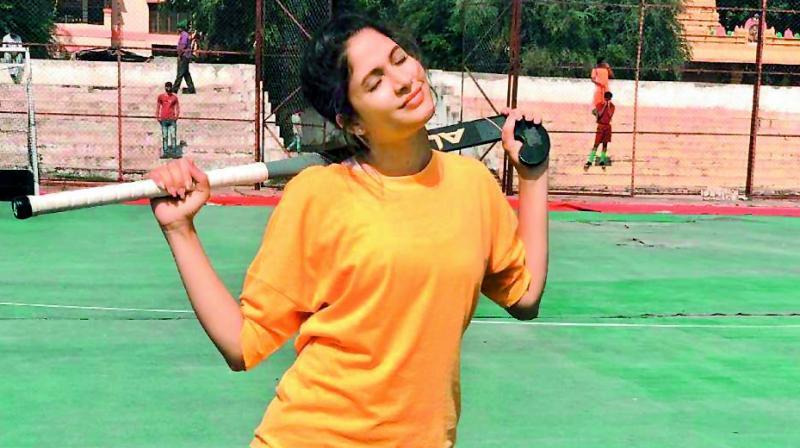 Lavanya posing at the hockey practice