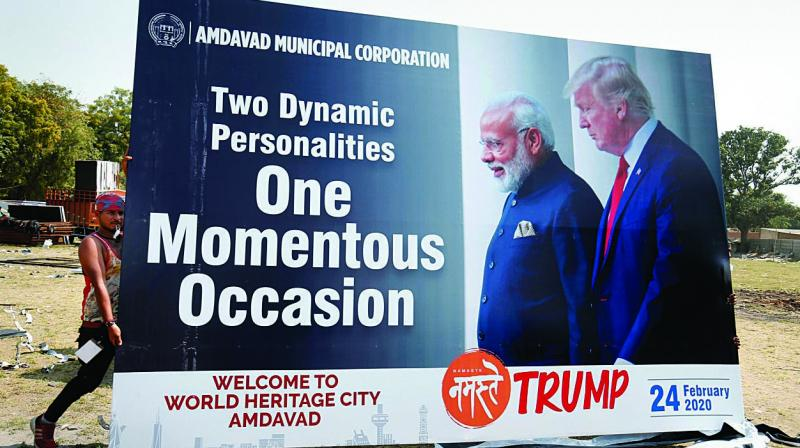 A hoarding with picture of US President Donald Trump and Prime Minister Narendra Modi for Trump's forthcoming 'Namaste Trump' event in Ahmedabad. (Photo: PTI)