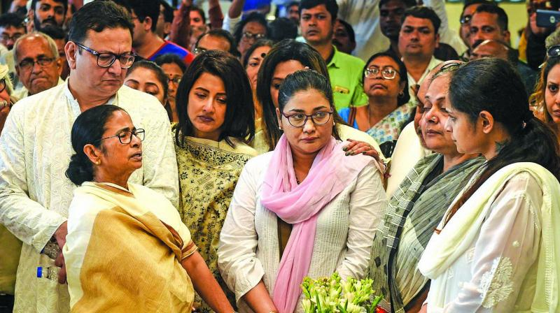 West Bengal chief minister Mamata Banerjee consoles the family members of veteran Bengali actor and former Trinamul Congress MP Tapas Paul after paying him the last respects in Kolkata on Wednesday. (Photo:  PTI)