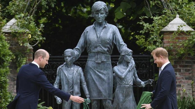 Britain's Prince William, left and Prince Harry unveil a statue they commissioned of their mother Princess Diana, on what woud have been her 60th birthday, in the Sunken Garden at Kensington Palace, London, Thursday July 1, 2021. (AP/PTI)
