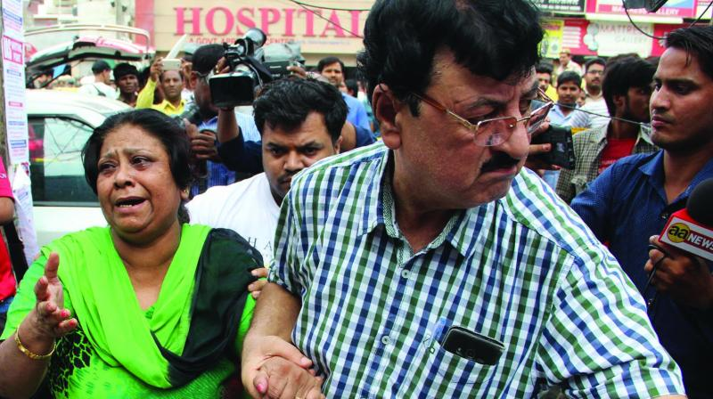 Relatives mourn after 11 members of family were allegedly committed suicide in Burari on Sunday. (Photo: Asian Age)