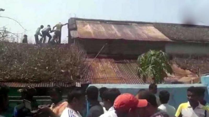 Firemen said the door was locked from the inside. Police suspect the three sisters killed themselves. (Photo: ANI | Twitter)